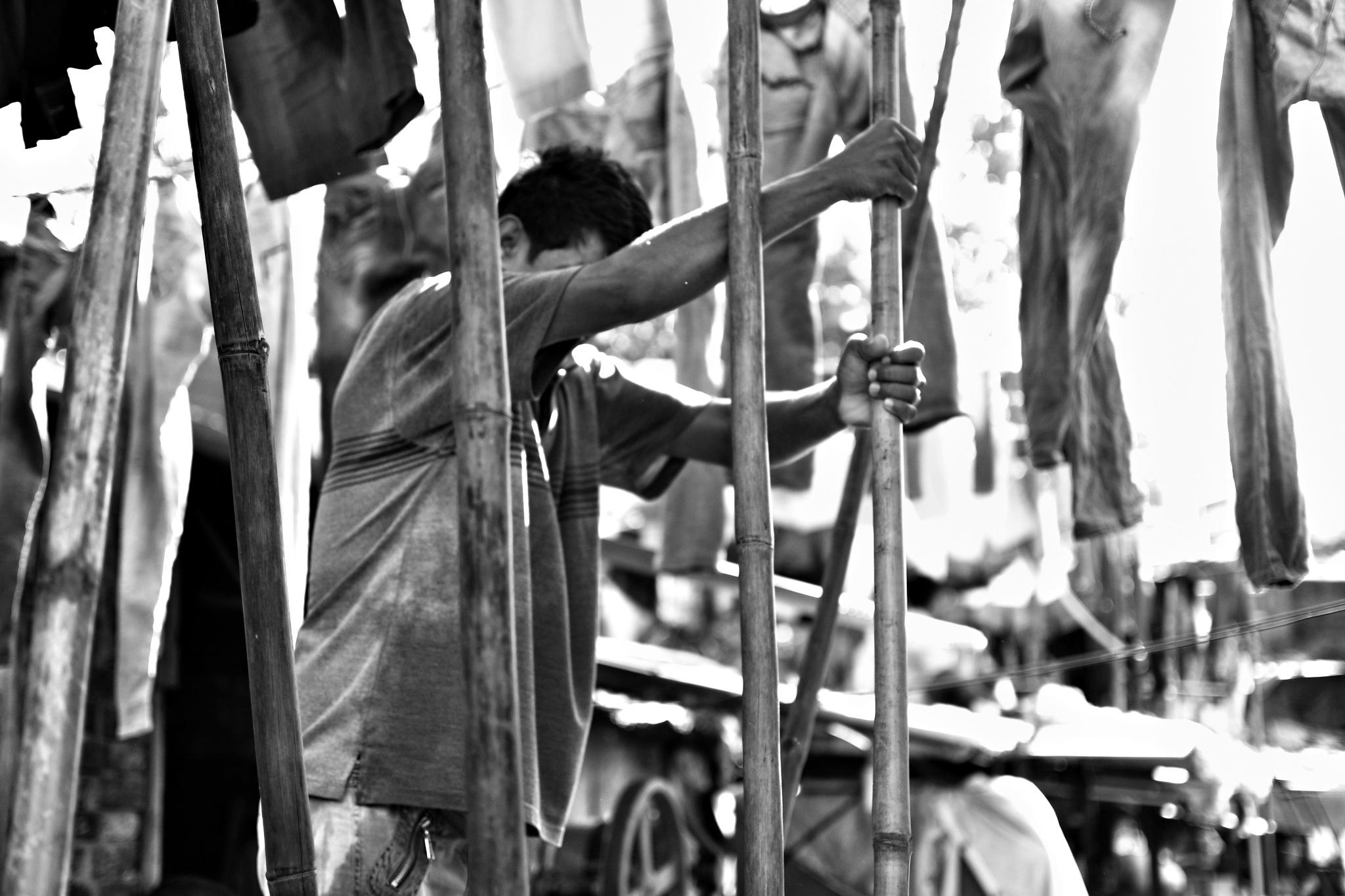 A washer at Dhobhighat. by Pratik Tambe