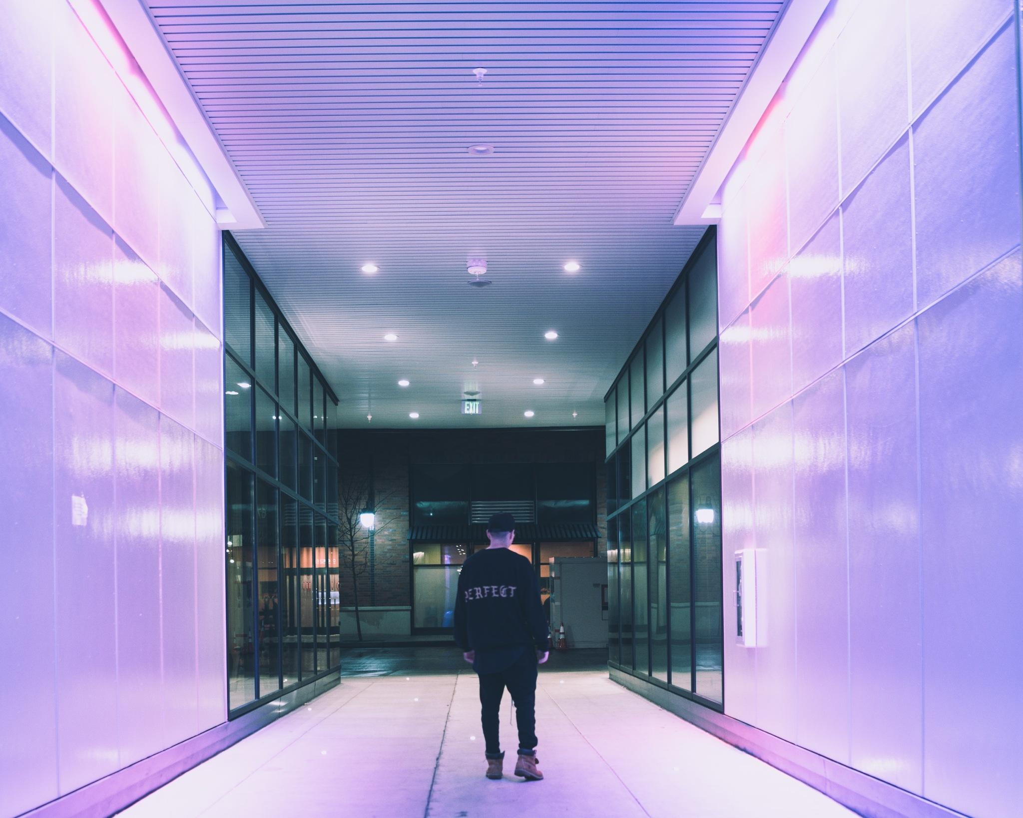 Purple lit hallway by Jon Sithiphong