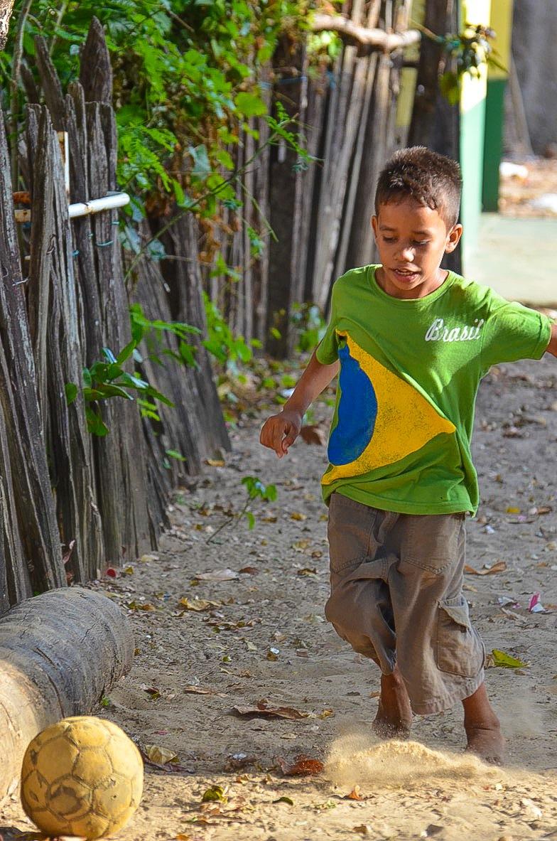 Brazilian street football  by Pierina Mariani
