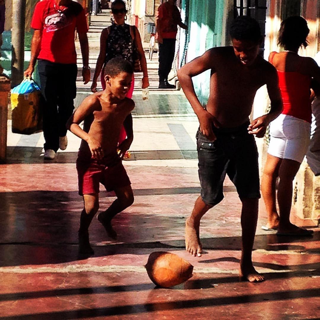 playing football by Riccardo Seggiani