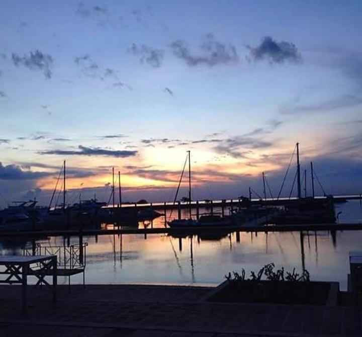 Sunset over ships by Ellessandra
