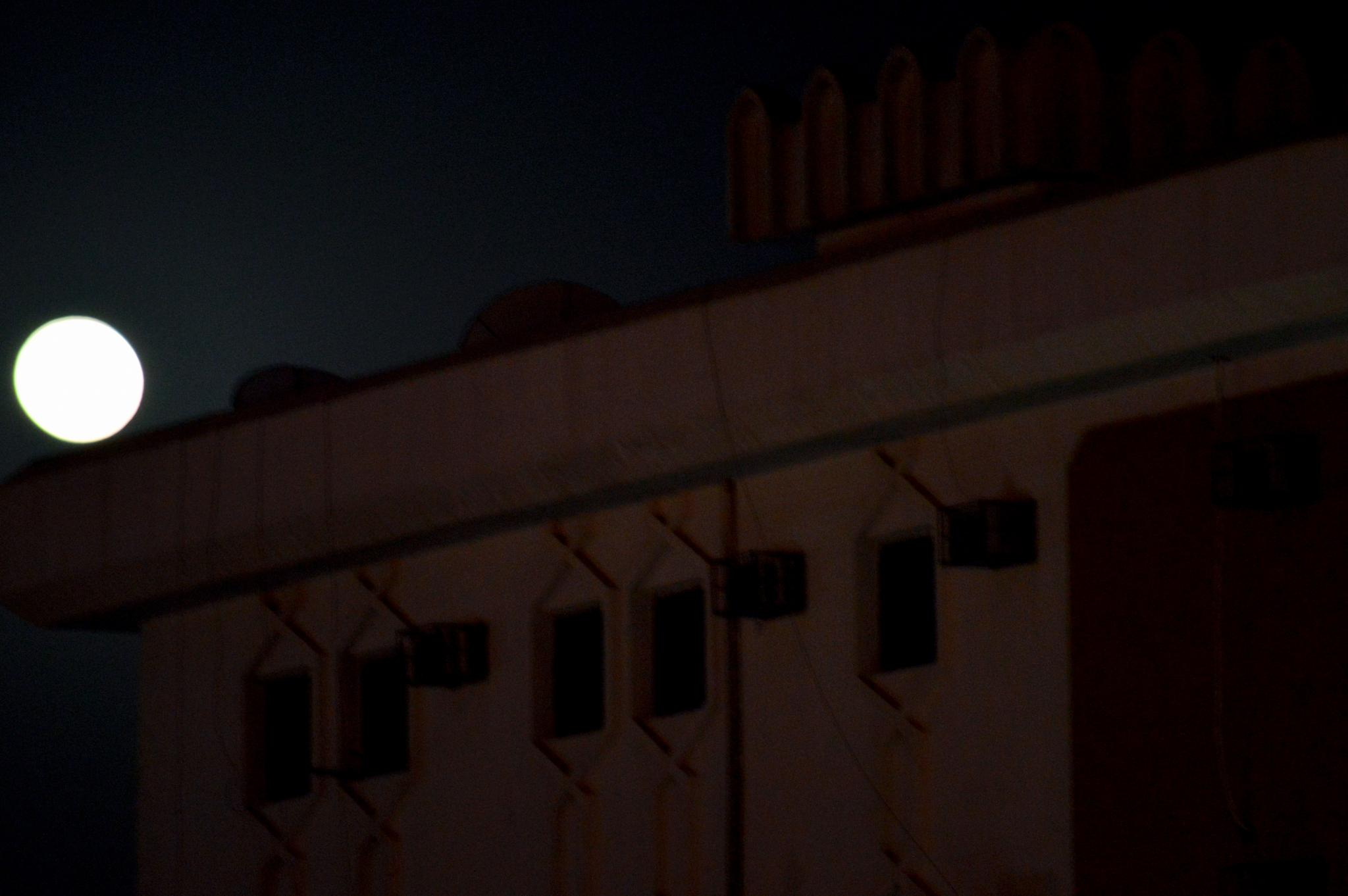 Moon on the roof by Cristo