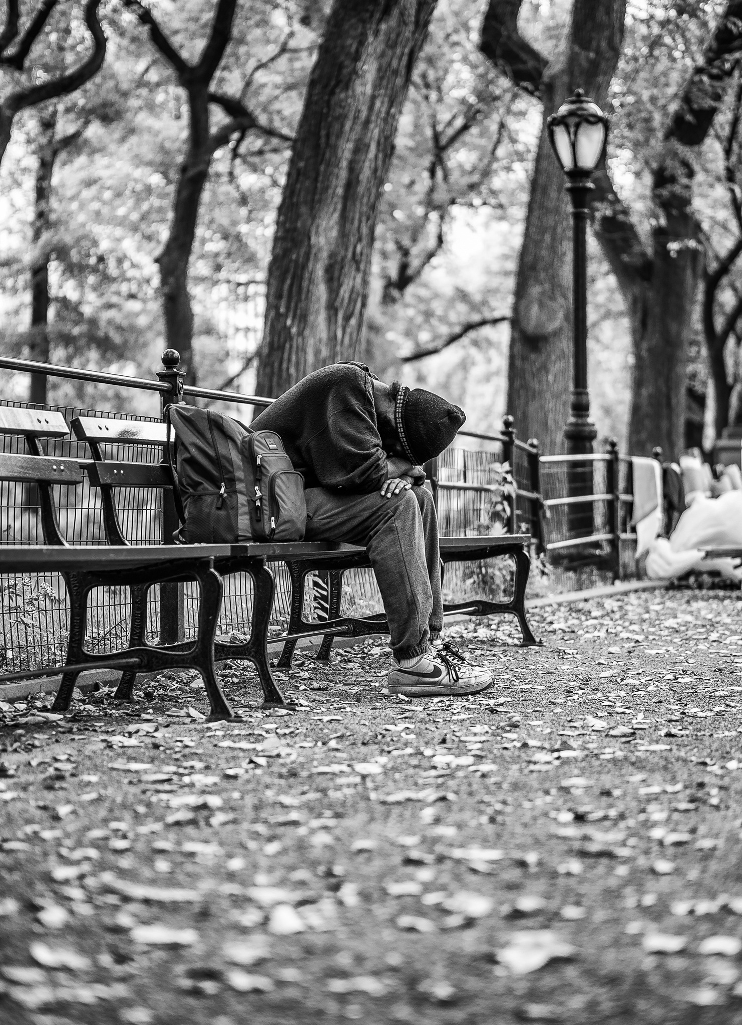 Photo in Street Photography #usa #bader.fabian #bader #america #unitedstatesofamerica #unitedstates #newyork #newyorkcity #ny #nyc #bigapple #manhattan #centralpark #park #day #blackandwhite #monochrome #streetlife #streetphotography #peoples #unsharpness #bestview #sleeping #homeless