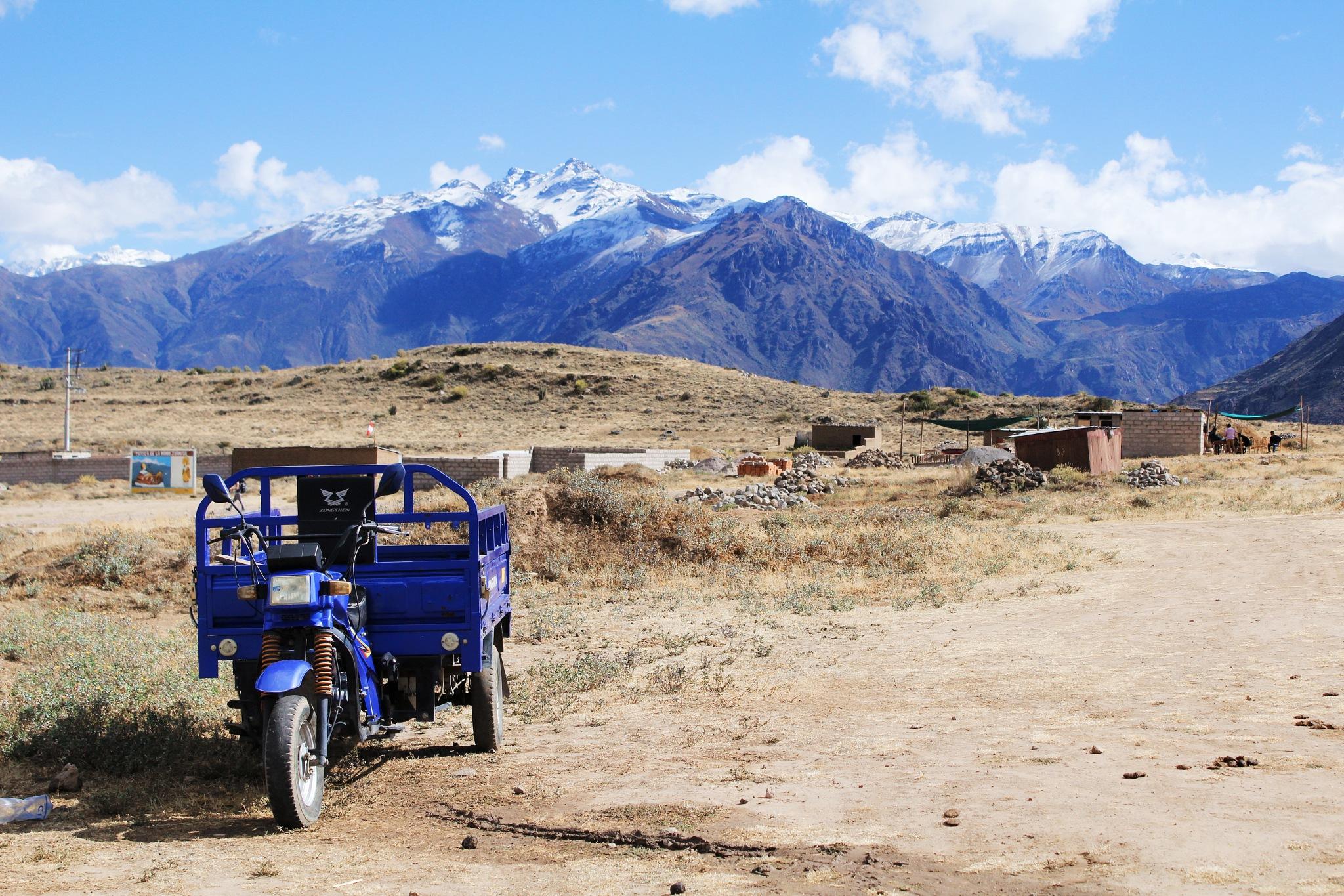 Photo in Landscape #mountain #mountains #motorbike #bikes #vehicle #dirt road #canon #canon rebel #nature #peru #south america #sudamerica #canyon #hike #hiking #blue