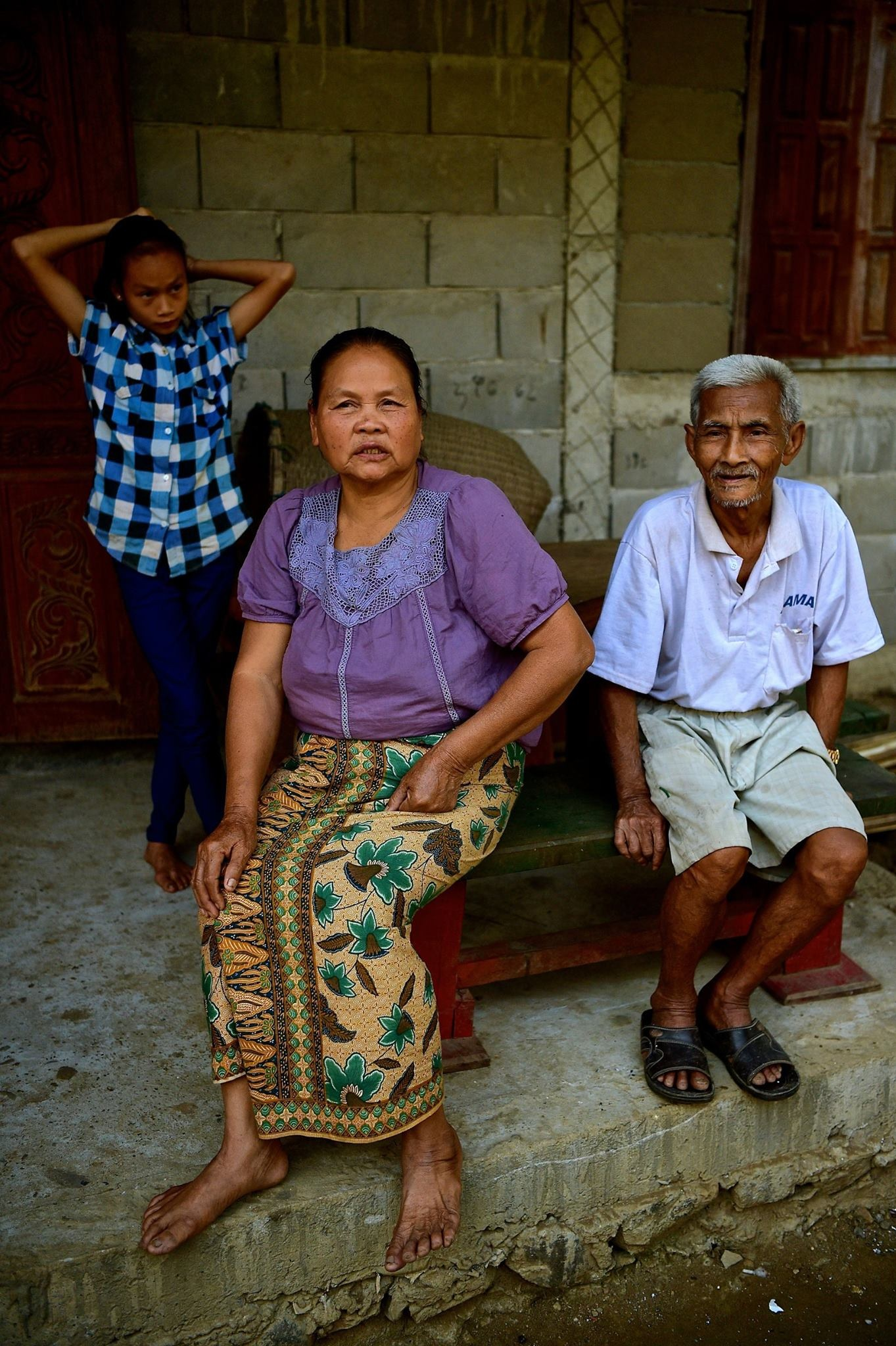 Laotian village family 2017 by Robert Malin Young