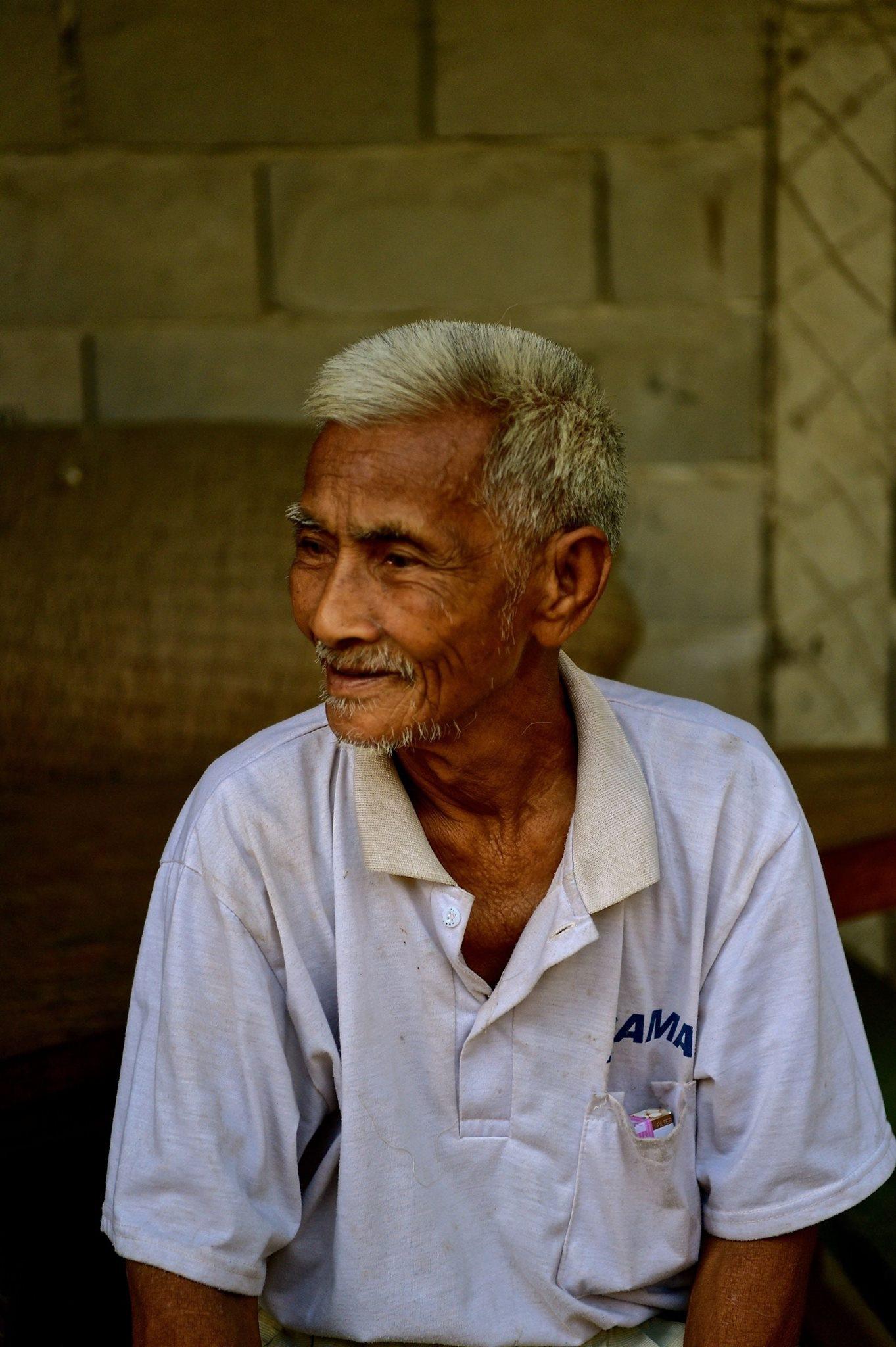 Laos - farmer 2018 by Robert Malin Young