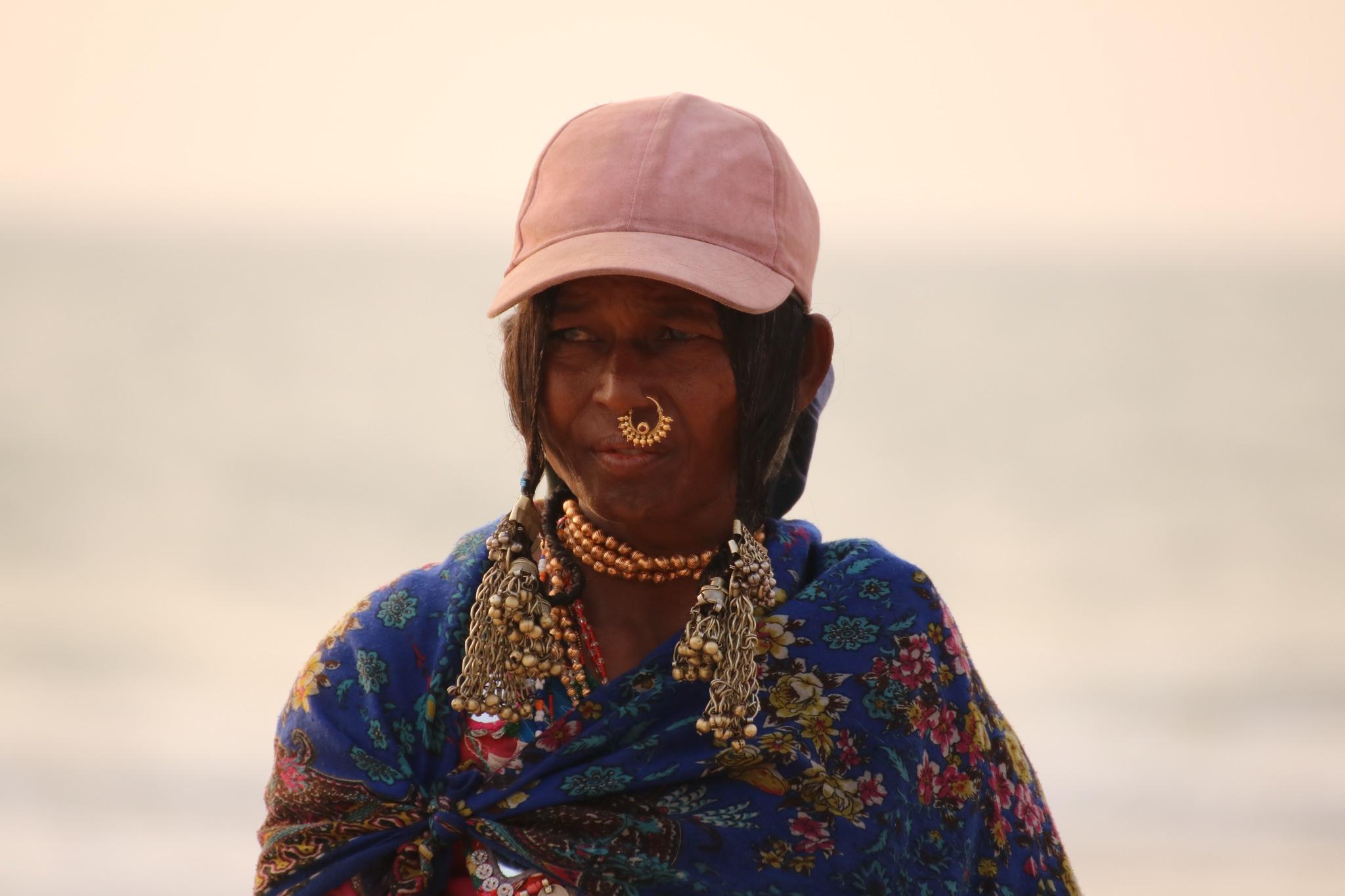 woman on the Goa beach by adriana gatej