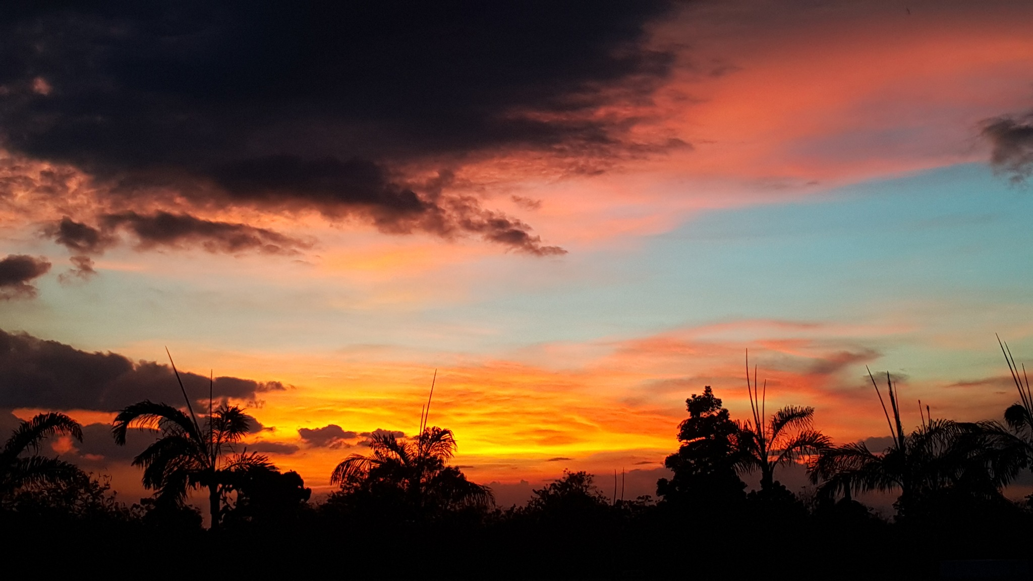 SUNSET BY THE CEMETERY by Corazon Quimbo