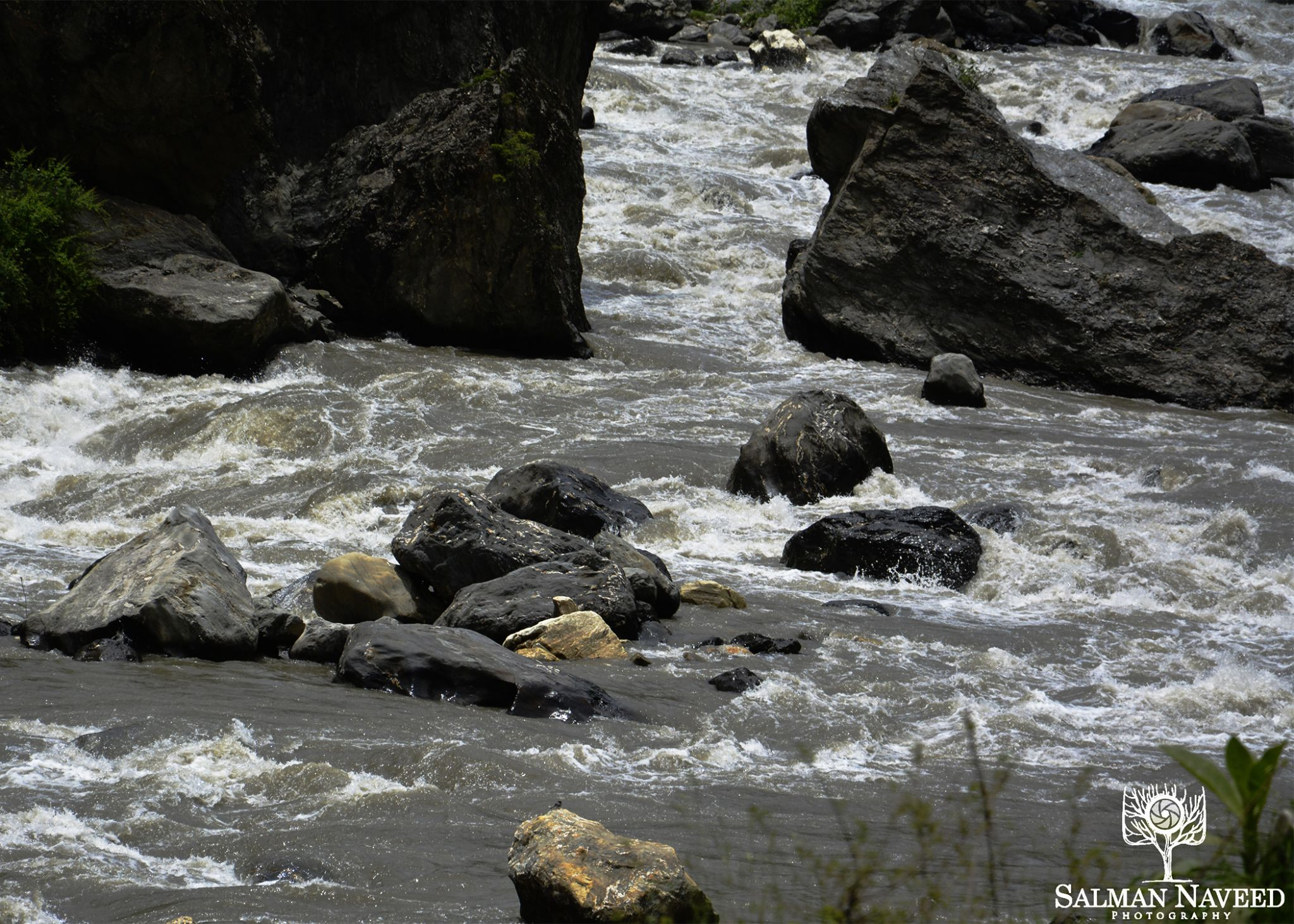Stones in the river. by Salman Naveed