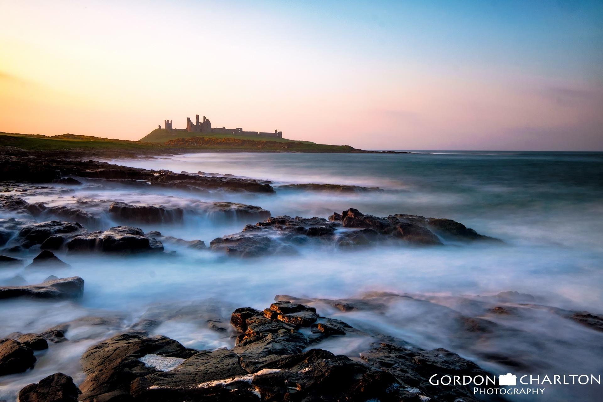 Sunset @ Dunstanburgh Castle by Gordon Charlton