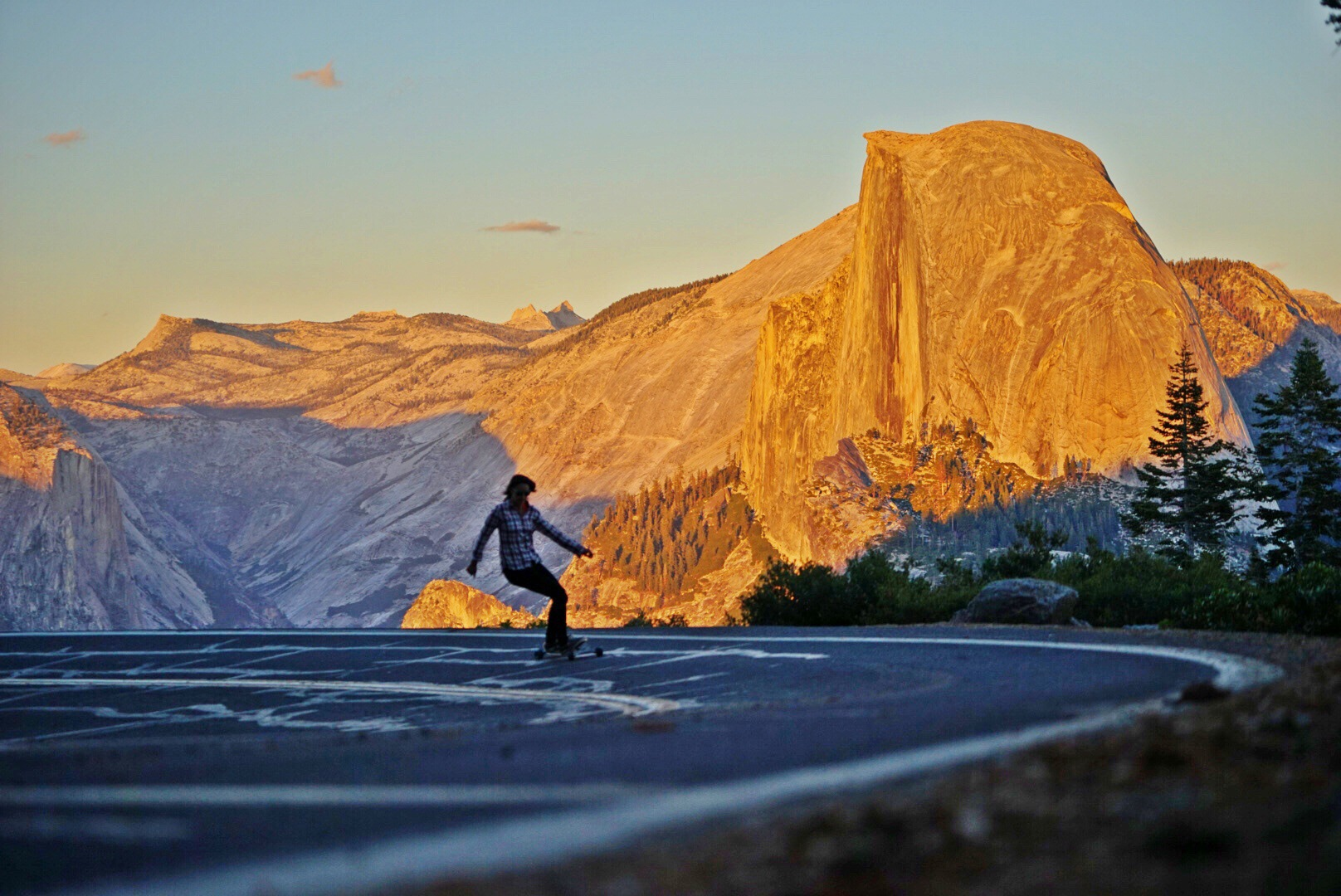 Skateboarding the open roads of Yosemite by Caleb Norman