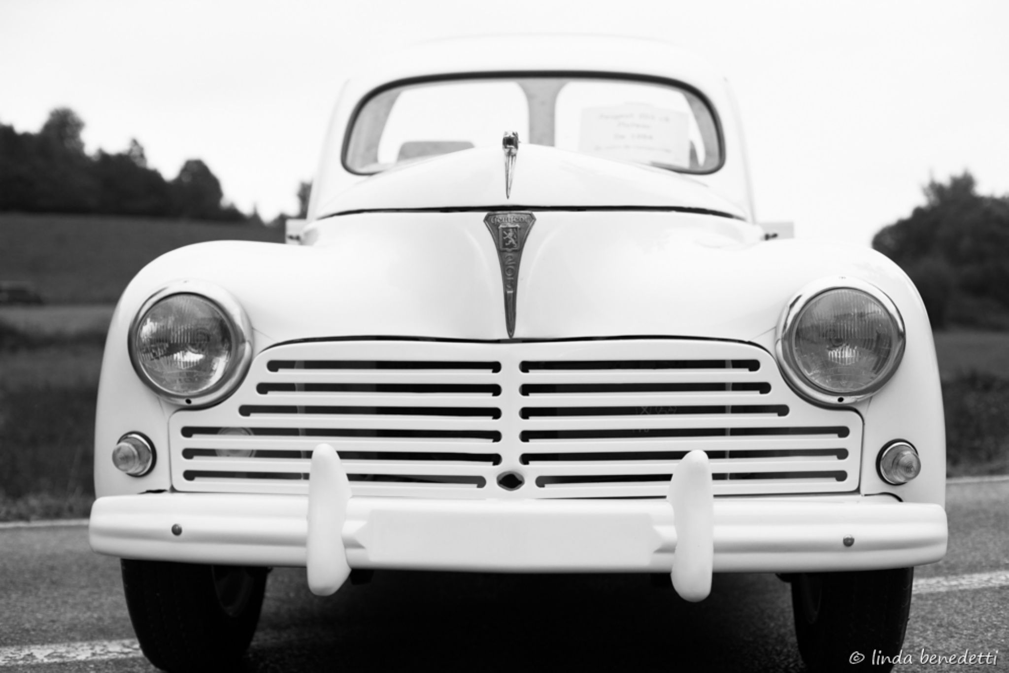 old white car by Linda