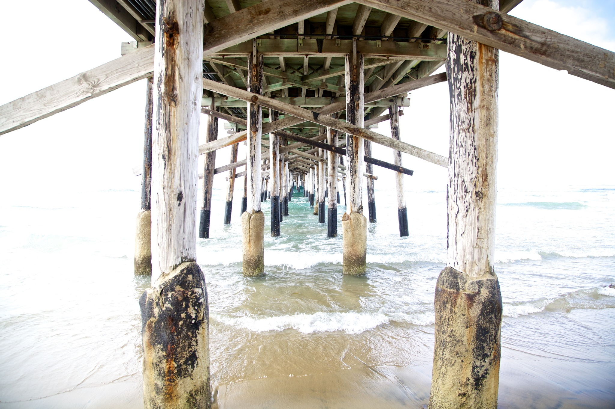 Under the pier by Kate Houlihan