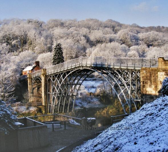 Ironbridge in spring snow  by John Chilver
