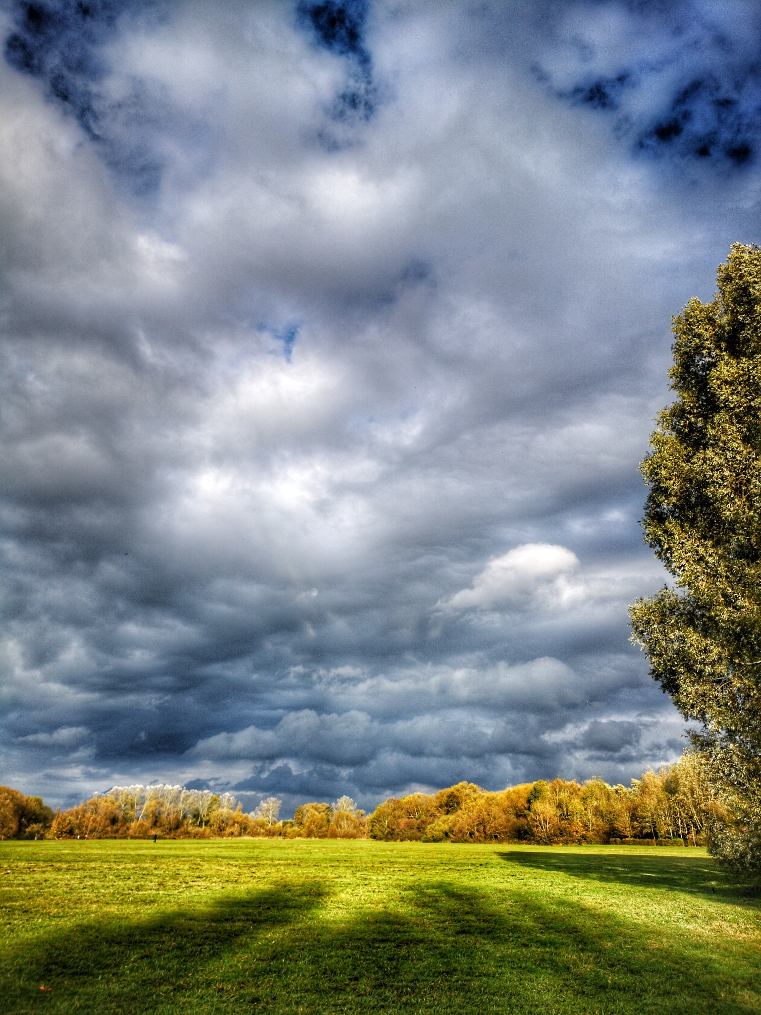 Clouds and long shadows  by Thomas White Photos