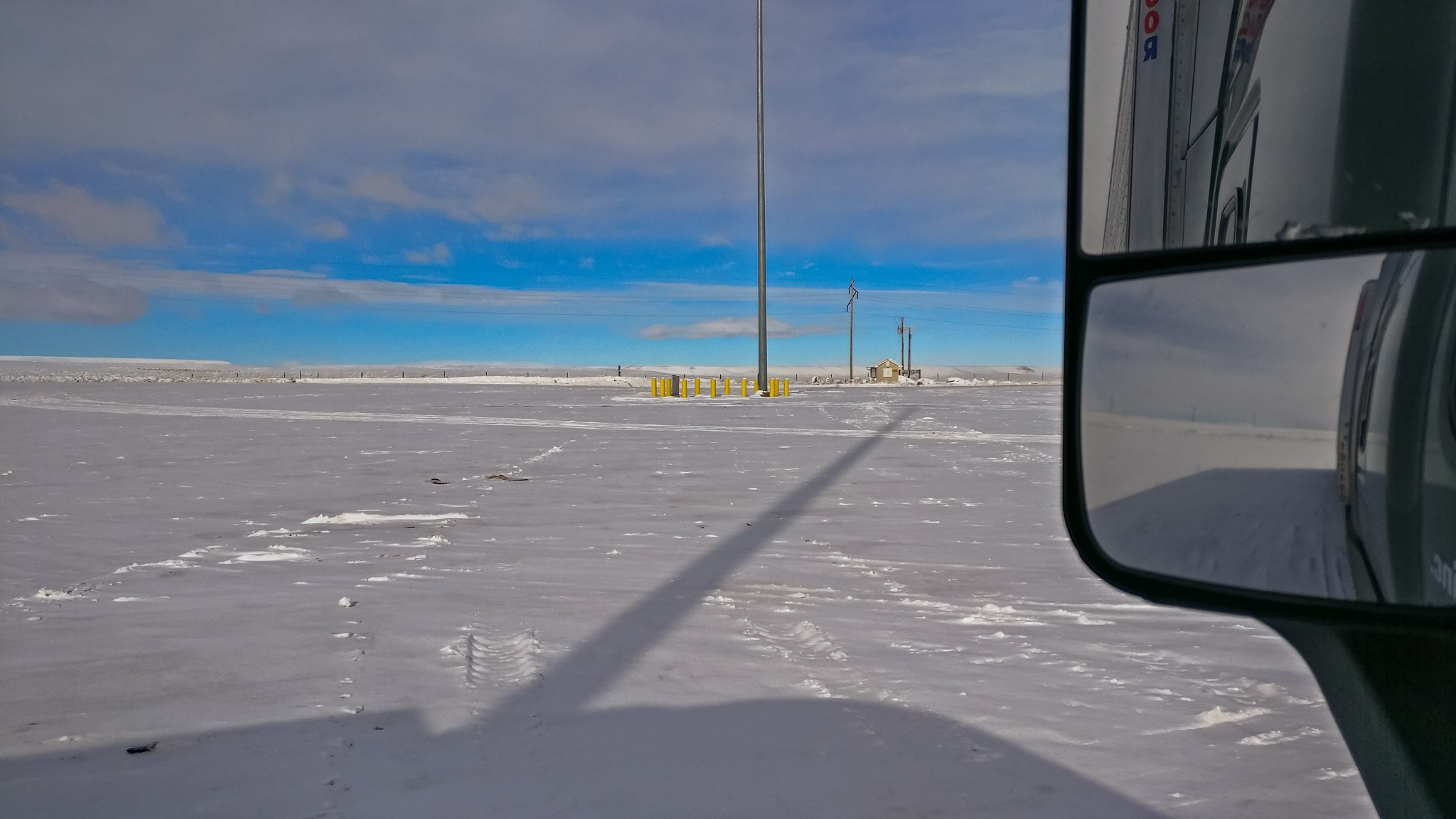 Photo in Travel #snow covered #clouds #winter #parking lot #wyoming #empty #peaceful #quiet