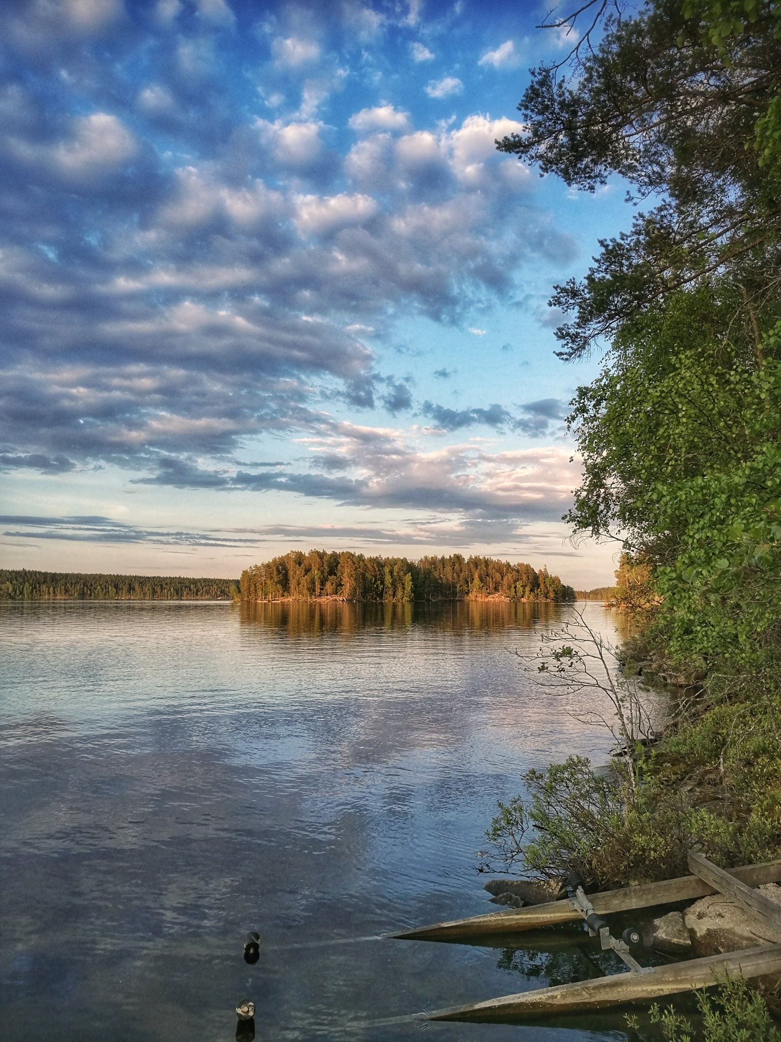 Summer clouds by lake Puula by Sini Paavonsalo