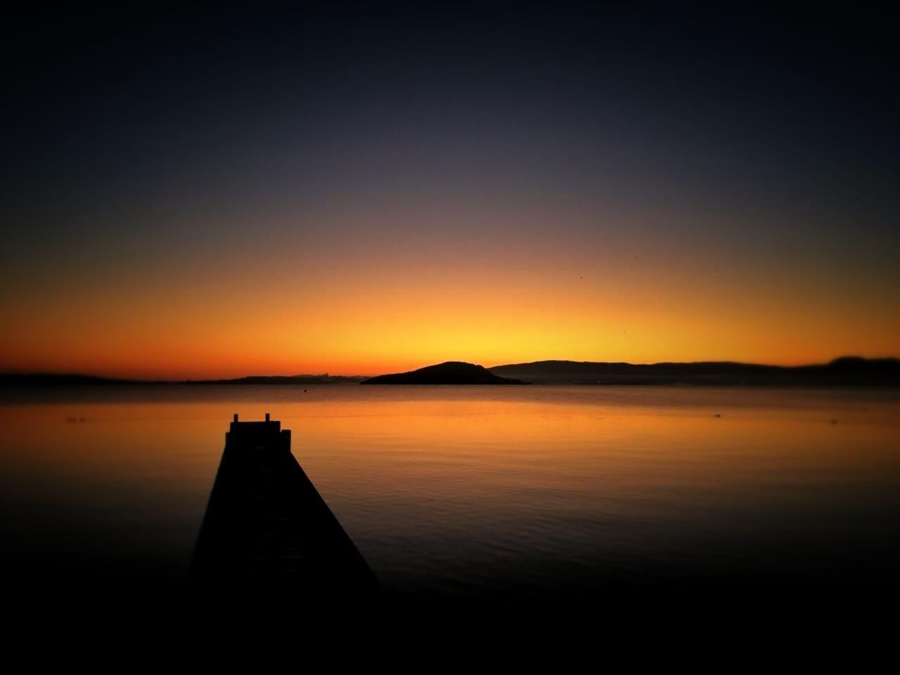 Sunrise at Rotorua Lake, NZ by Kerstie Cooper