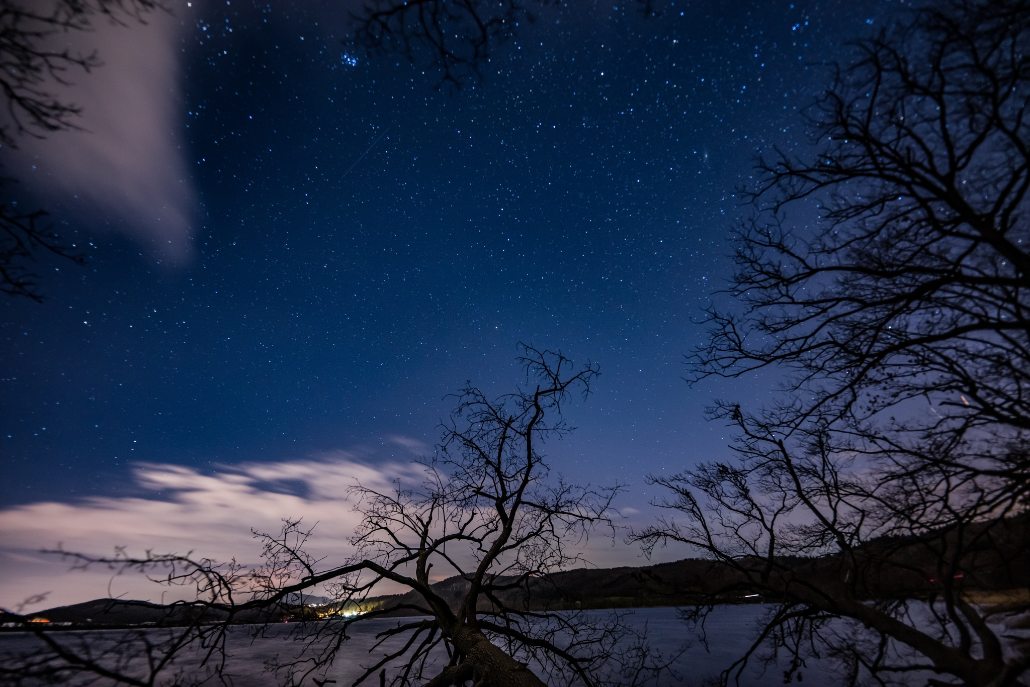 Photo in Astrophotography #germany #eifel #deutschland #astrofotographie #astrophotographers #astrophotography #amazing #longexposure #lakeside #lake #winter #trees #bäume #sternenhimmel #nachtfotografie #nightphotography #night photo #available light #stargazing