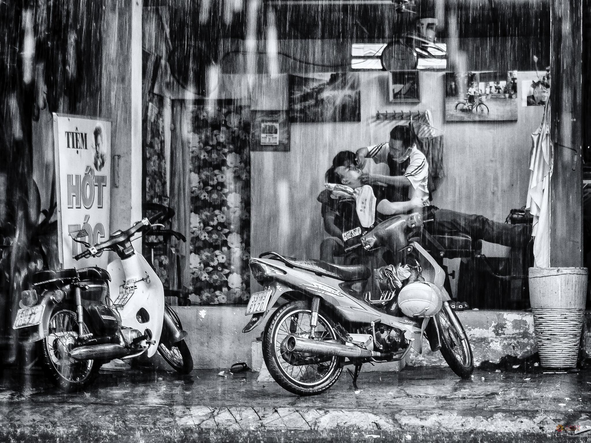 Shaving under monsoon by Sylvain Marcelle