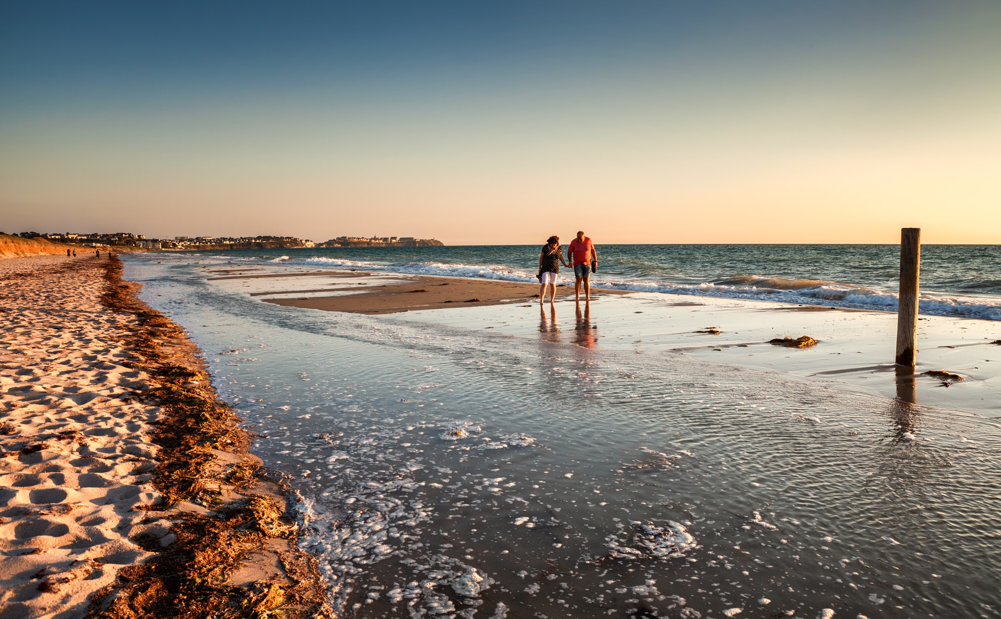 Walkers on the beach by Sylvain Marcelle