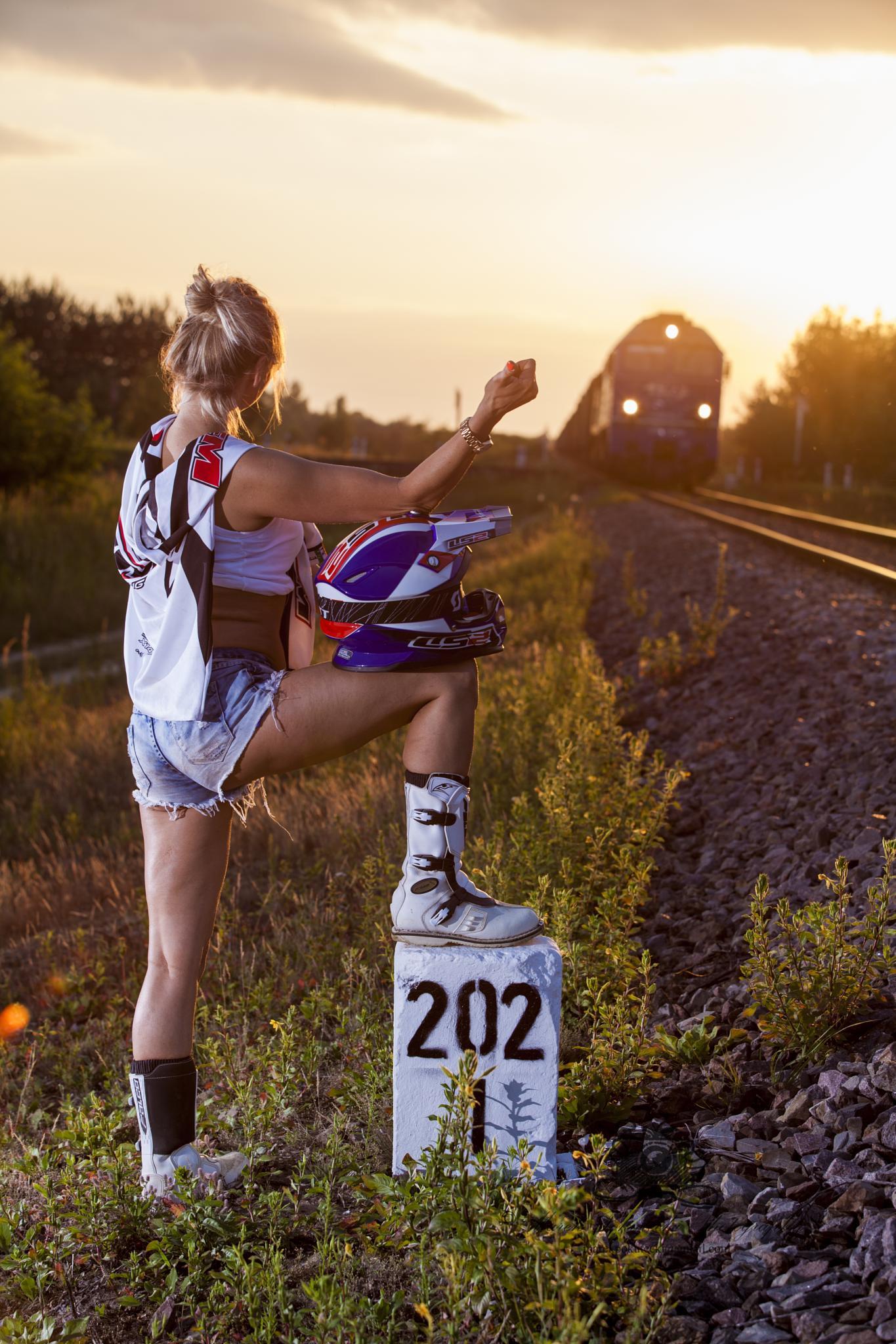 Motocross girl stops the train by Marek Pokutecki