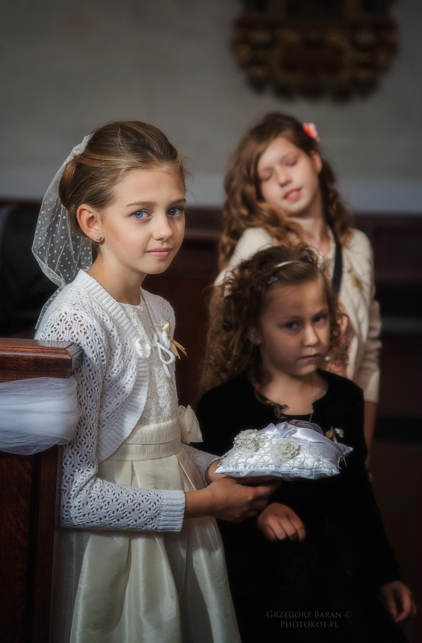 The girls in the church by Grzegorz Baran