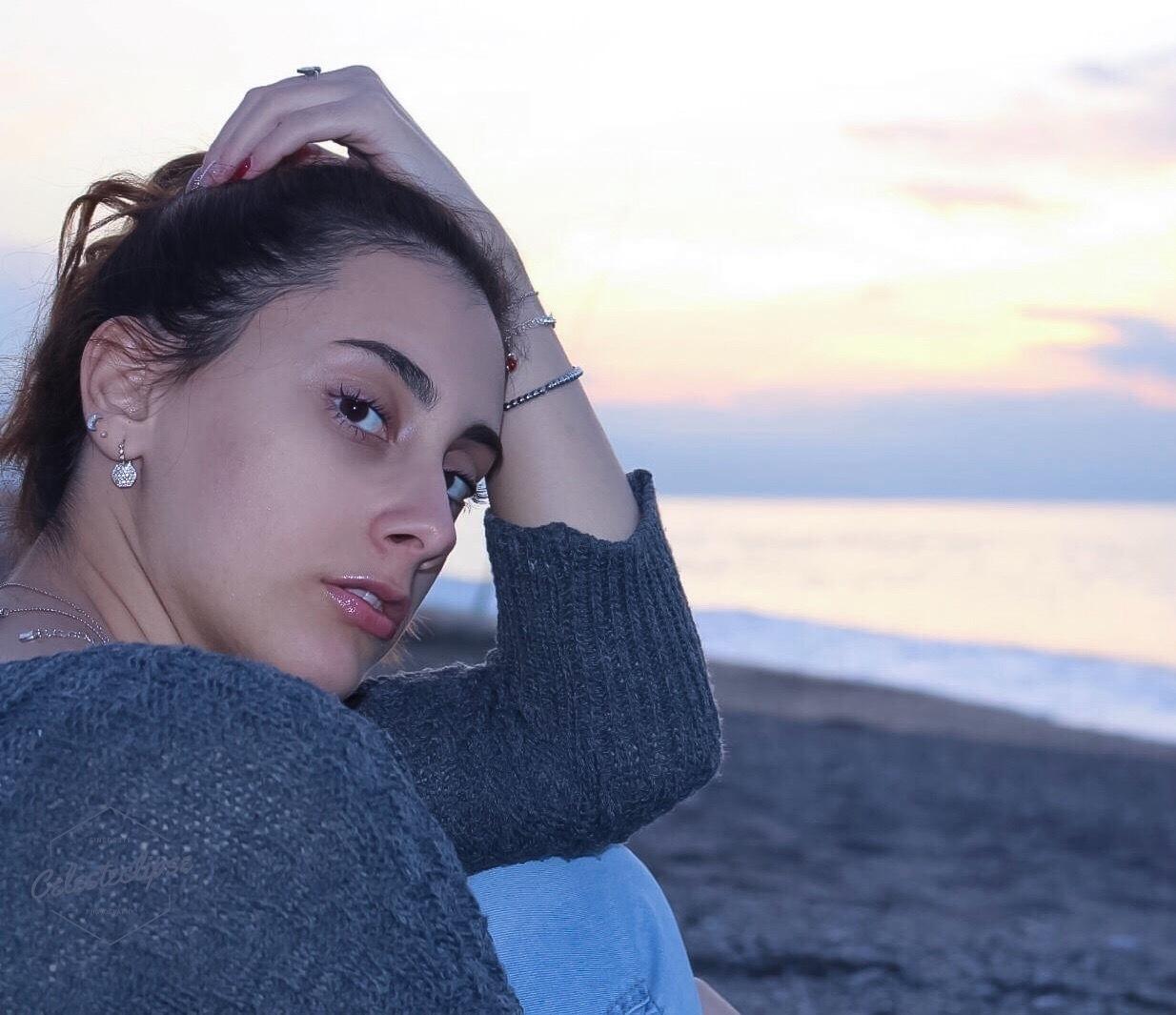 Photo in Portrait #girl #portrait #sunset #color #blue #sand and sea #beach #model #nature #landscape #sea #sand #random #fine art #photography #people #sun