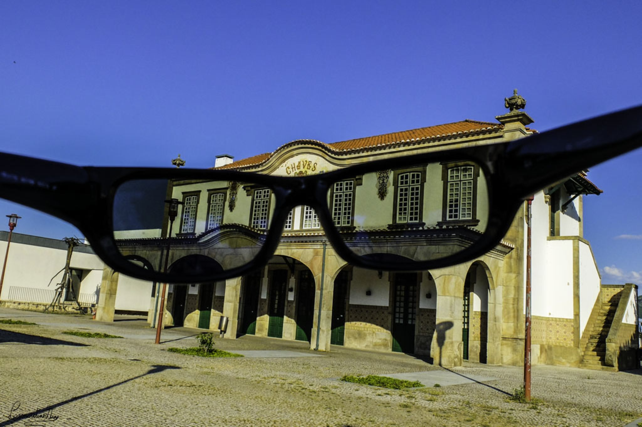 Through glasses by Lamartine Dias