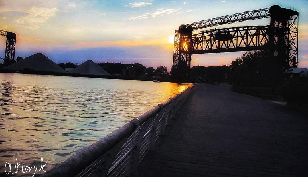 Train Bridge over Lake Erie at Sunset  by Akenzik