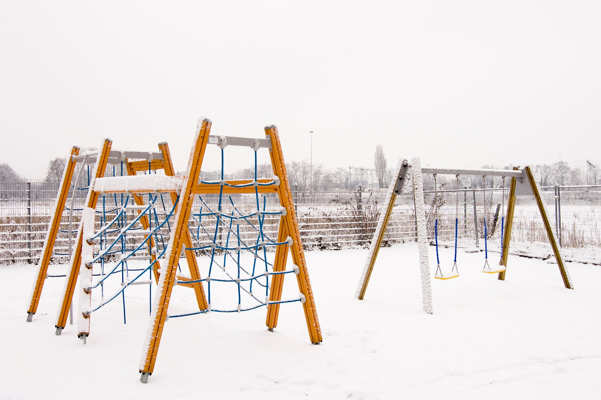 Playground in the snow by Helga Kuiper