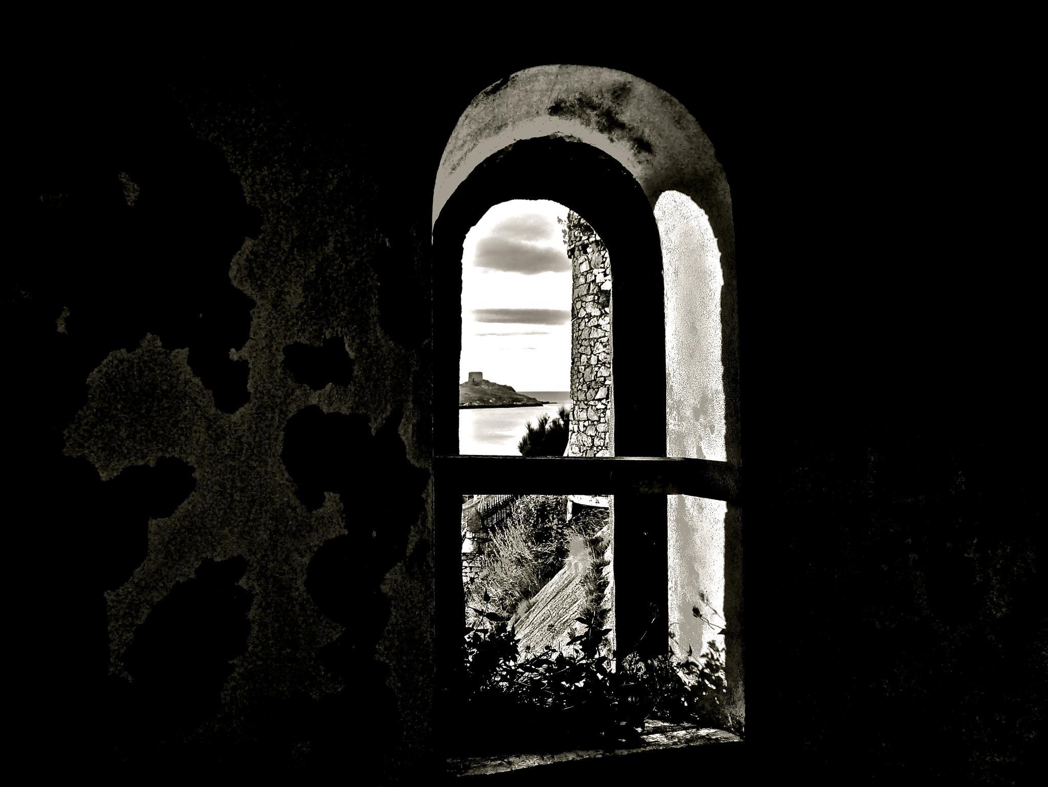 martello tower through window by Desmond O'connor photography