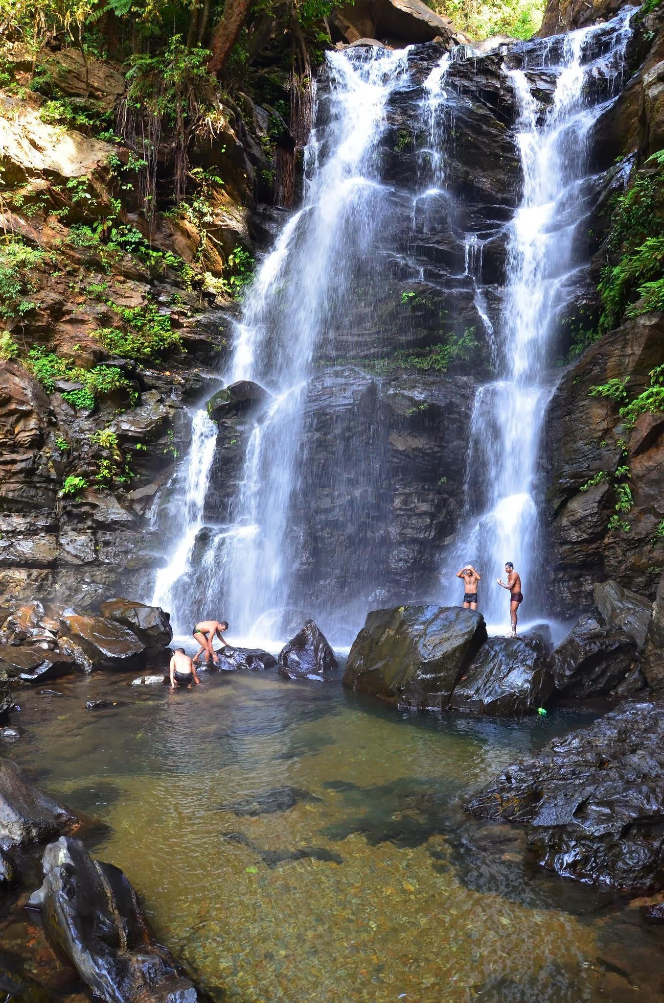 Bathing under the waterfalls...  by sriramshankars