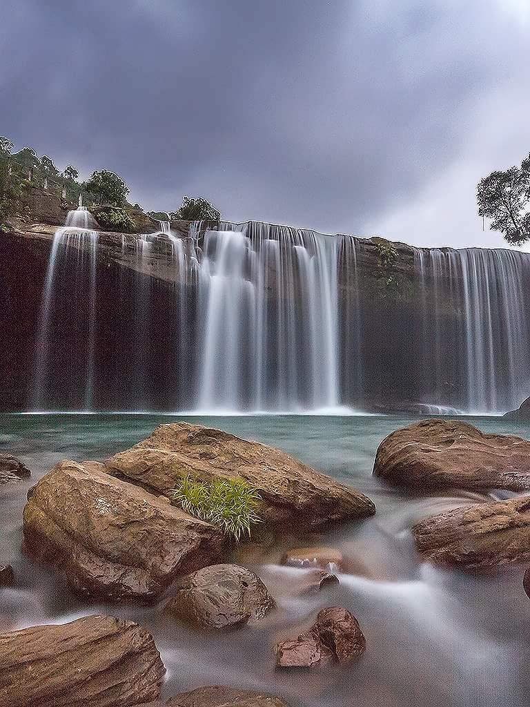 krangsuri Waterfall  by Bhaskar