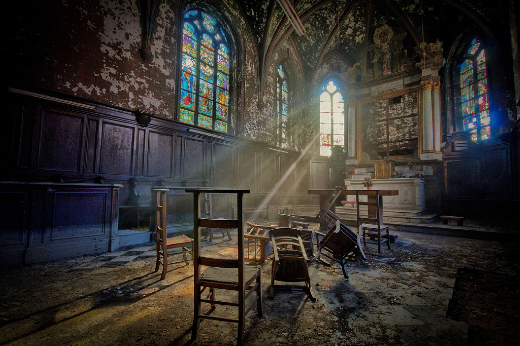 Lightfall on decayed chapel by Joël Arys