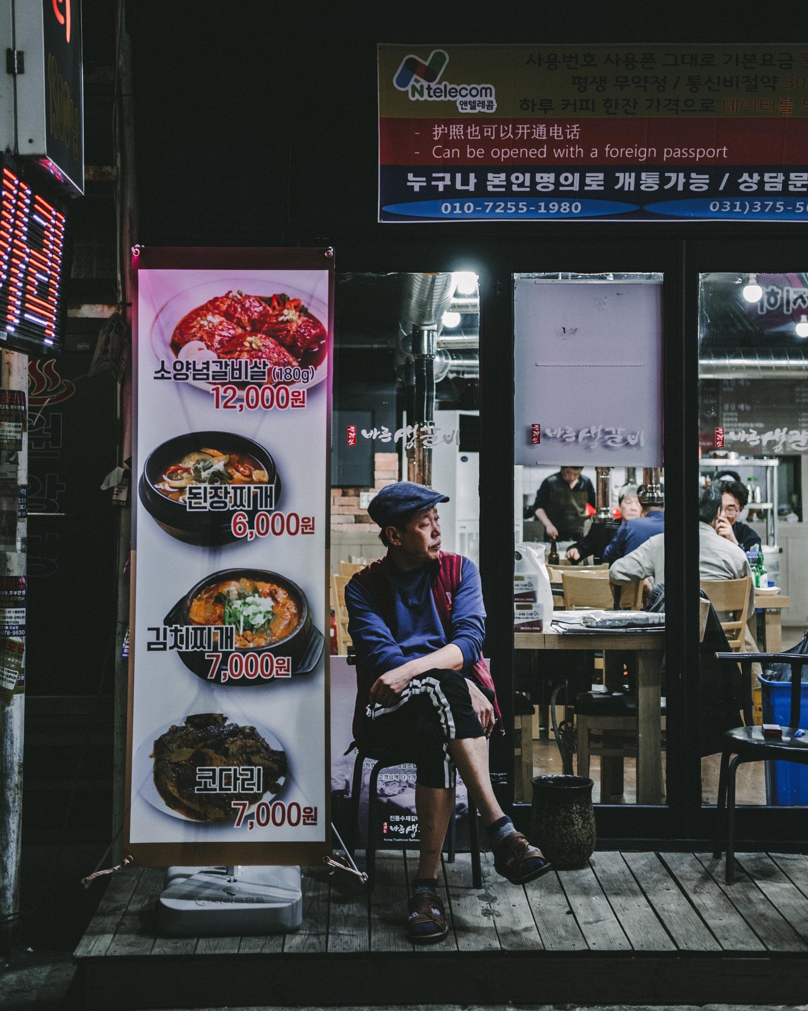 Under the storefront lights by Ishmael Legaspi