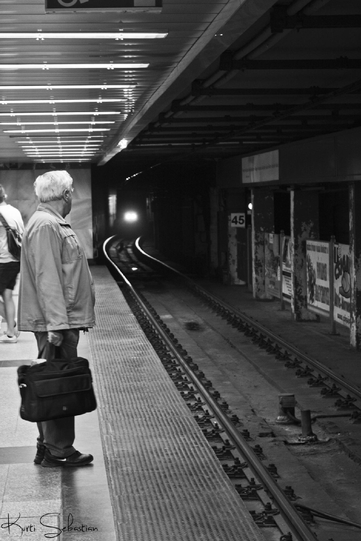 Old man waiting in the underground subway by Sebastián Kurti