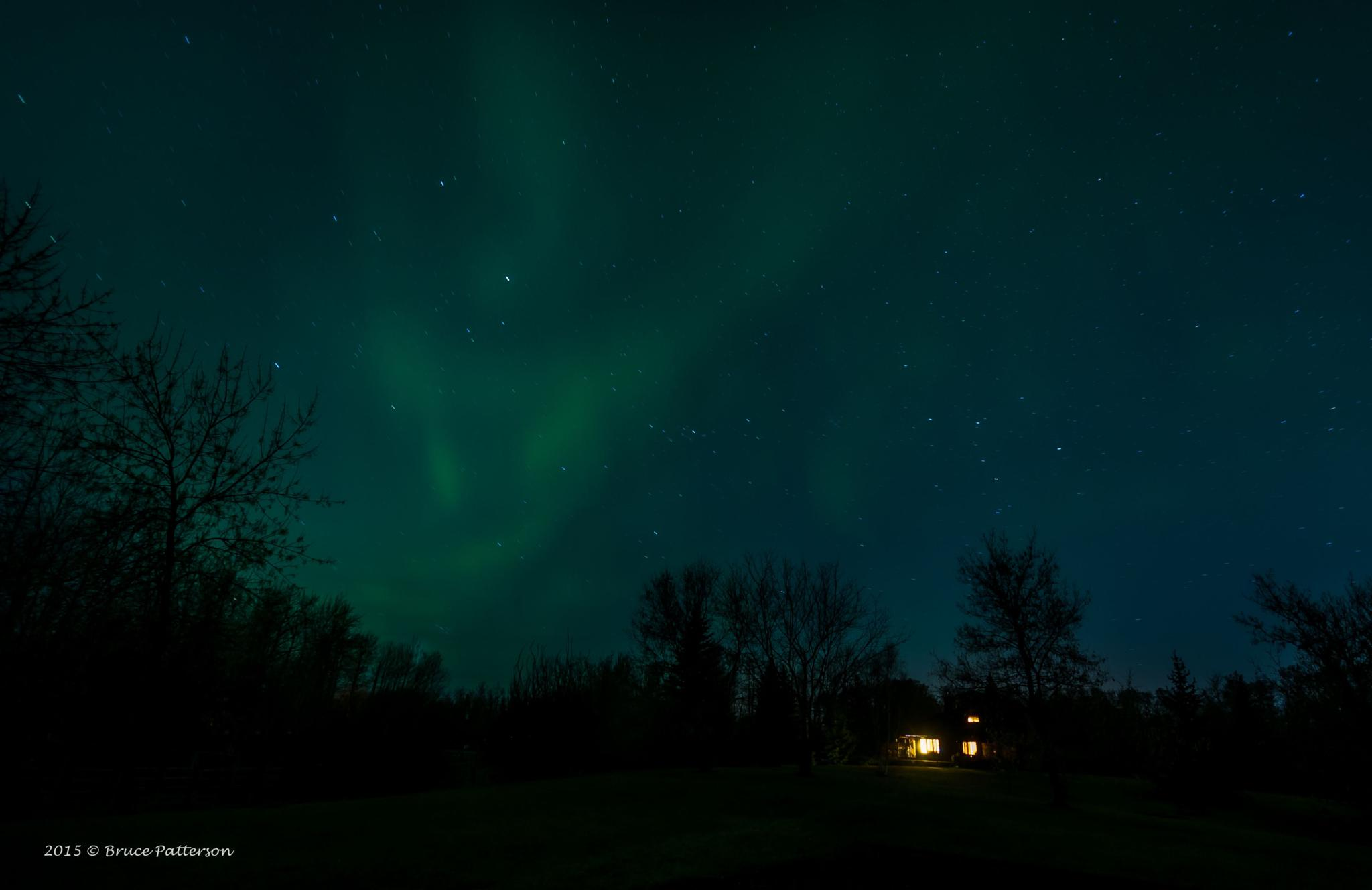 Northern Lights Over Little House by Bruce Patterson
