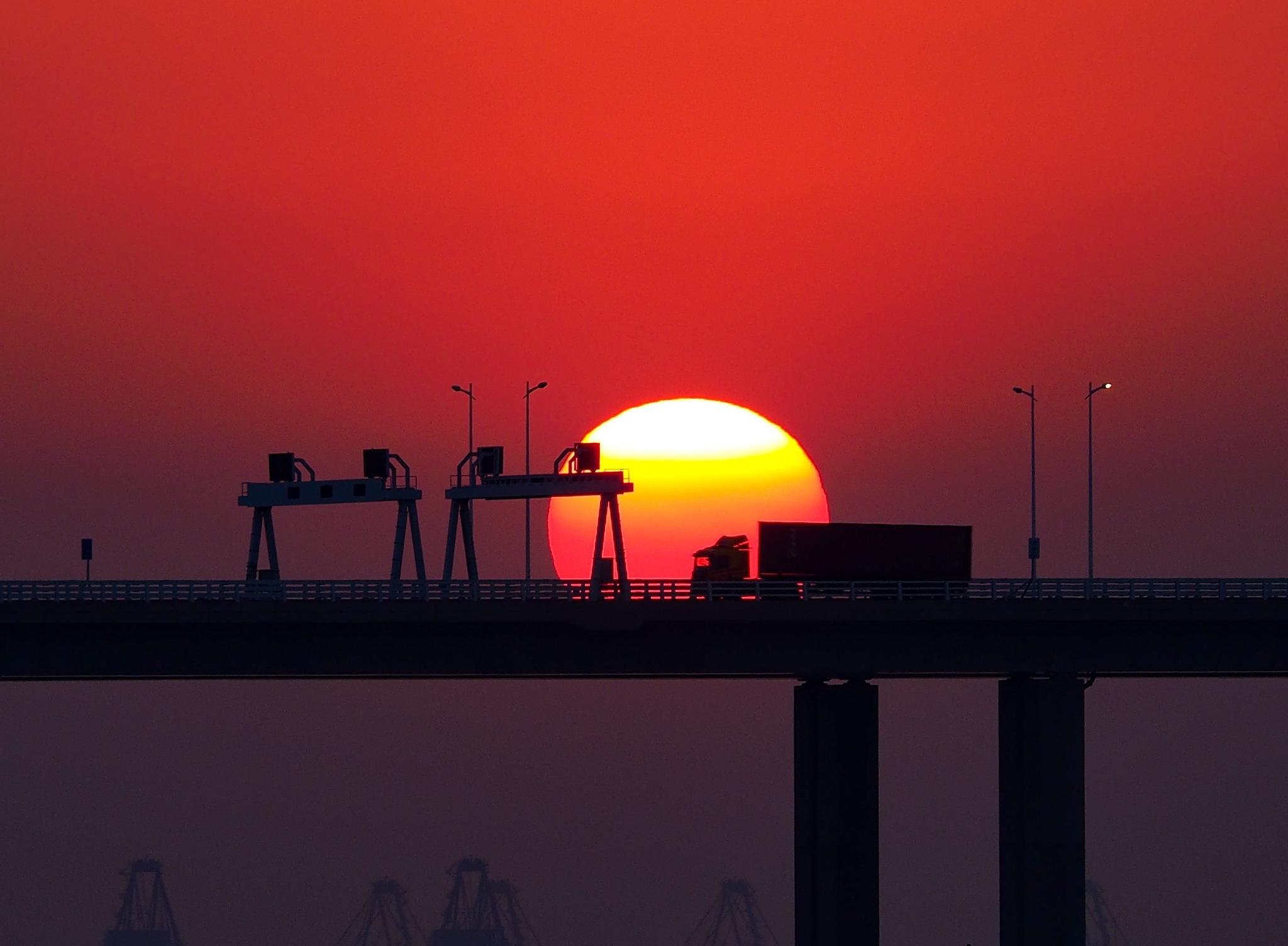 Sunset on bridge by David SK Yu