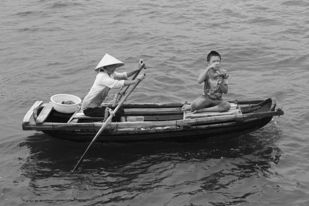 Vietnamese boat traders by RichardWynne