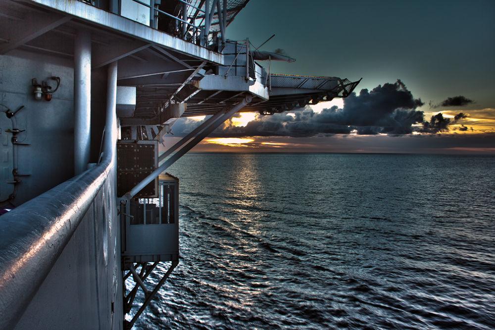 Sunset off the USS Essex by timmygrey