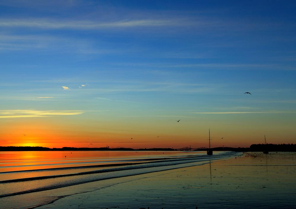 Sunrise over the river by Laurence Bissett