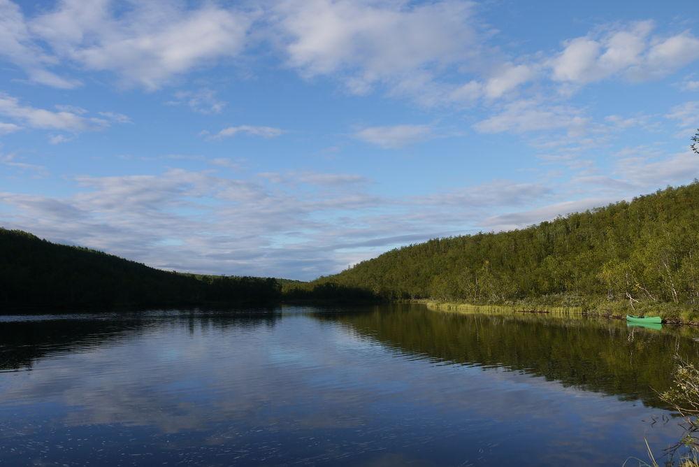 Calm water and a canoe! by E Pedersen