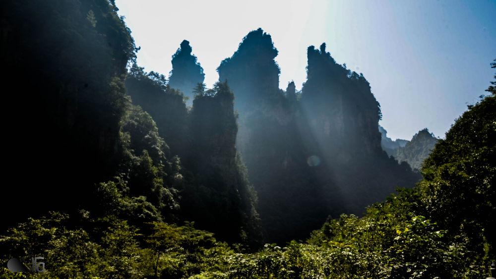 the sun is rising - zhangjiajie - wulingyuan by An Nguyen