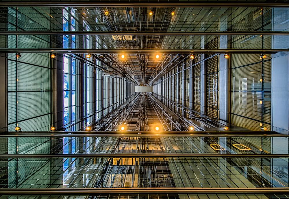 Photo in Architecture #chicago #hdr #elevators #sky #glass #steel #lines #dimension #pov