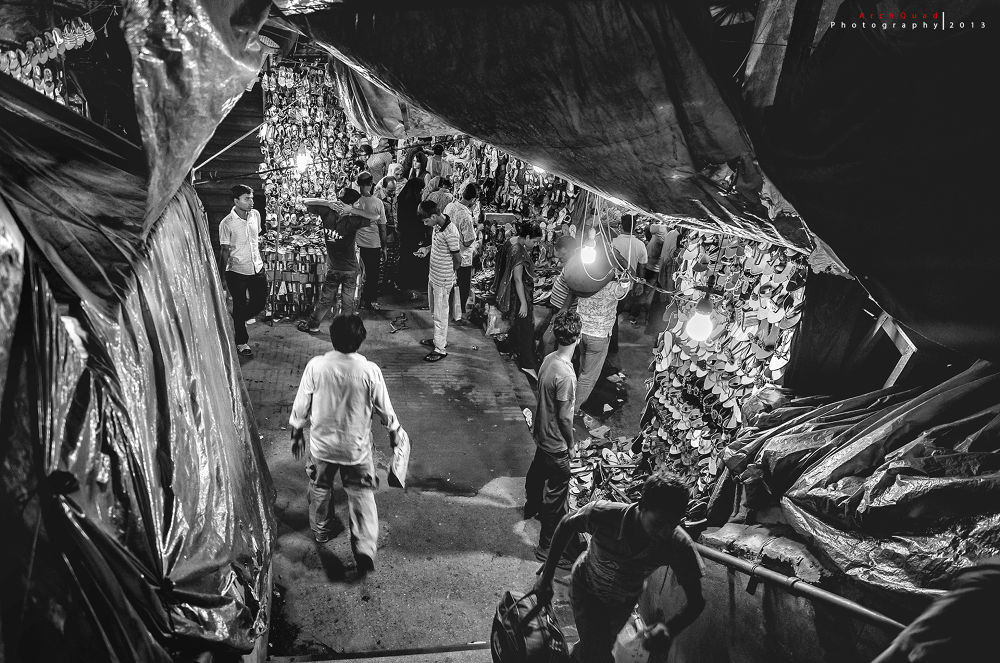 Photo in Street Photography #lifestyle #street #documentary #shoe #footwear #market #nilkhet #dhaka #nikon #d5100 #black and white #bnw