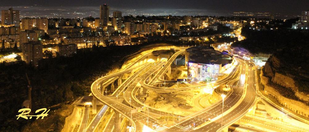 haifa grand canyon mall at night by ronhahamo