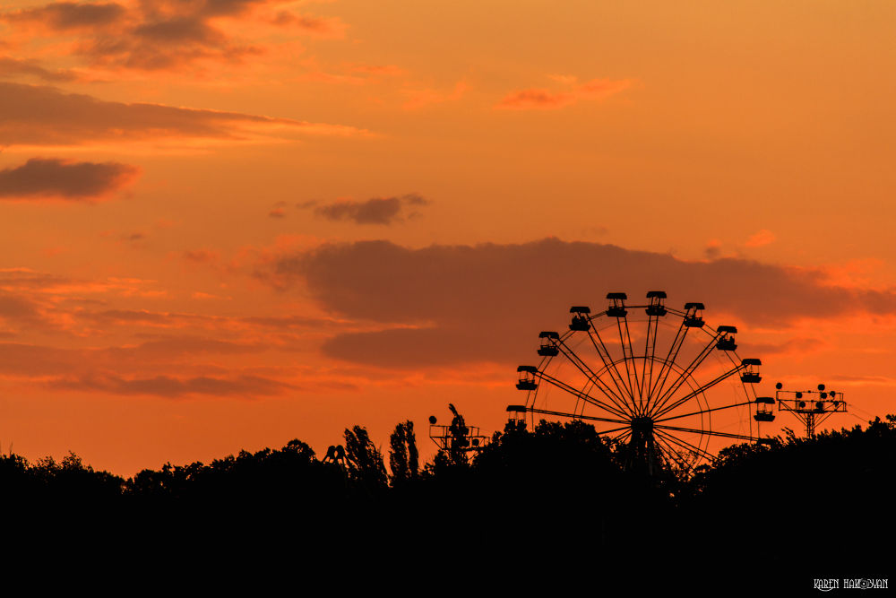 Ferris Wheel At Sunset by Kar Yan