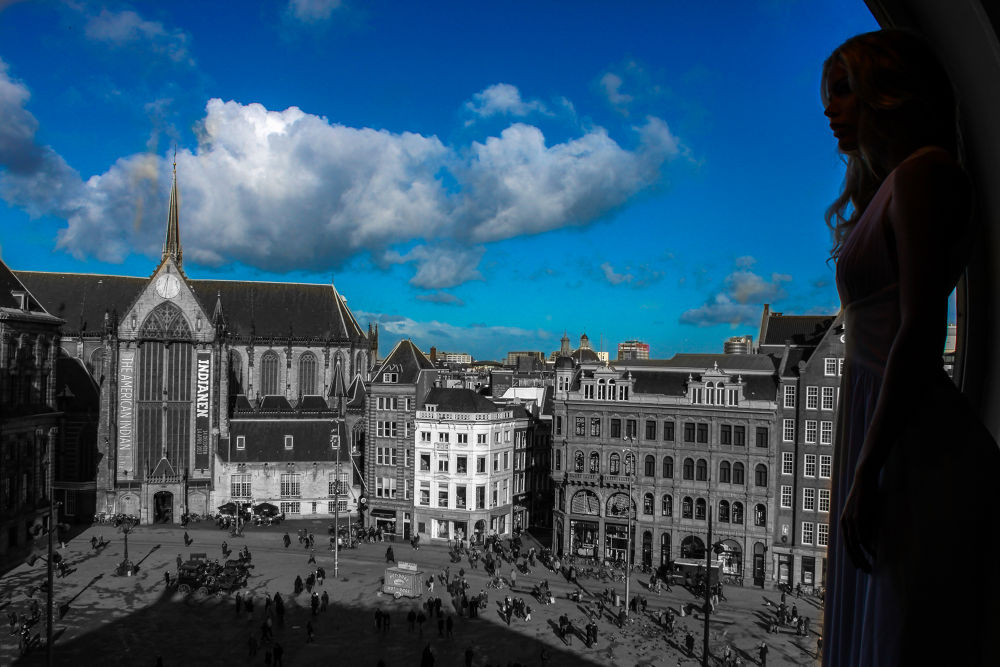 Photo in Cityscape #amsterdam #city #view #girl #woman #black and white #sky