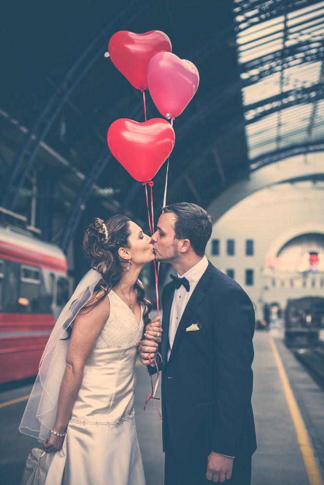 Photo in Wedding #wedding #couple #wedding dress #suit #bride #groom #hearts #balloons #kiss #train station #veil #train